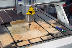 Milling machine for wood during operation Stock Photo
