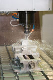 Milling machine working - cooling liquid Royalty Free Stock Image