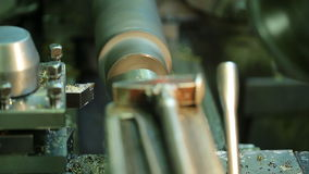 Milling metal spinning parts of machine closeup. Removing part of milling machine this blade, it is made from a more durable alloy than workpiece. Detail stock footage