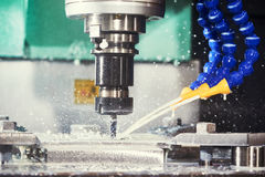 Milling metalwork process. CNC metal machining by vertical mill. Milling metalworking process. Precision industrial CNC machining of metal detail by cutting mill Stock Photo