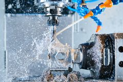 Milling metalworking. CNC metal machining by vertical mill. Coolant and lubrication. Milling metalworking process. Industrial CNC machining of metal detail by royalty free stock photos