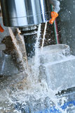 Milling metalworking process. Industrial CNC metal machining by vertical mill. Milling metalworking process. Industrial CNC machining of metal detail by cutting royalty free stock images