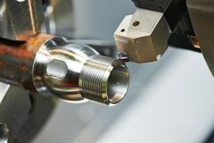 Milling process of metal on machine tool. Milling detail on metal cutting machine tool at factory Stock Photo