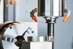 Milling process on precision CNC machine by vertical mill Royalty Free Stock Photos