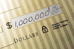 Million Dollar Check. Macro Closeup of Check Made Out for One Million Dollars Royalty Free Stock Photo