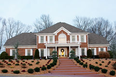 Million dollar homes. New million dollar homes in affluent neighborhood, sales are steady royalty free stock photography