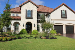 Million Dollar Homes. Million dollar home with beautiful landscaping stock photo