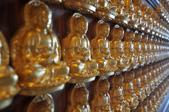 Million of golden Buddha statue in chinese temple Nonthaburi Stock Photo