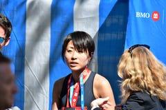 Milliseconde Yuko Mizuguchi a gagn? le 1er endroit femelle au maraton de Vancouver photographie stock libre de droits