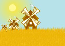 Mills in the grain field. Windmills in the grain field. Wheat crop Royalty Free Stock Photos