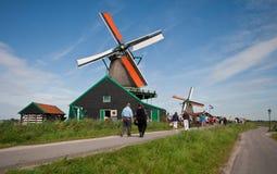 Mills in Holland. Mills and tourists in the neighbourhood of Zaandam at Koog aan de Zaan Royalty Free Stock Photos