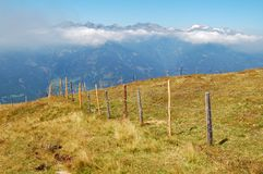 Millstätter Alps. View from top of austrian mountains above Millstatt. A fence divides the meadows Stock Images
