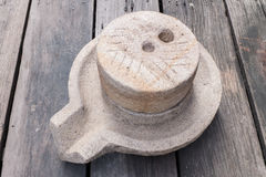 Millstone na drewnianej podłoga Obrazy Stock