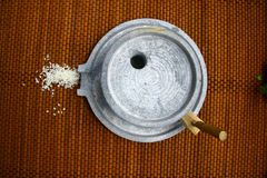 Millstone and rice Royalty Free Stock Photo