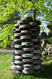 A millstone. Millstone standing in the middle of a garden showing spring which has arrived Royalty Free Stock Photo