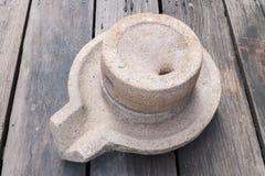 Millstone on wood floor Stock Images
