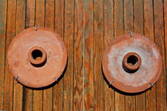 Millstones on the wall Royalty Free Stock Image