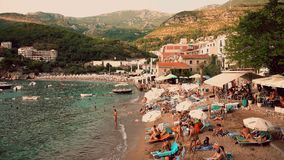 Free MILOCER, MONTENEGRO - AUGUST 1, 2018. Small Crowded Beach In The Evening Royalty Free Stock Photography - 124870007