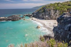 Milopotamos beach in Greece. Rocky cliffs and clear turquoise sea stock photos