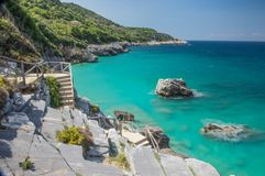 Milopotamos beach in Greece. Rocky cliffs and clear turquoise sea stock photo