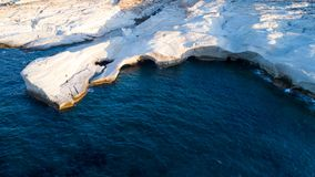 Milos island Greece aerial detail of Sarakiniko Beach in summer time. Milos island Greece , detail of Sarakiniko Beach in summer time ,grayish-white volcanic royalty free stock image
