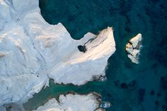 Milos island Greece aerial detail of Sarakiniko Beach in summer time. Milos island Greece , detail of Sarakiniko Beach in summer time ,grayish-white volcanic stock images