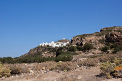 Milos landscape. In the distance Plaka village, South Aegean. View of Plaka village, above Panagia Thalassitra church stock photography