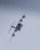 Miltary transport aircraft in flight Stock Photos