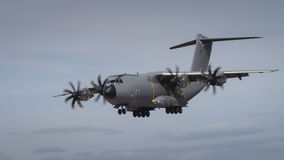Miltary transport aircraft in flight Royalty Free Stock Image