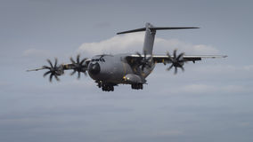 Miltary transport aircraft in flight. An airbus A400M Atlas aircraft in flight Royalty Free Stock Photos