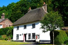 Milton Abbas Post Office. View of the thatched post office along the main village street, Milton Abbas, Dorset, England, UK, Western Europe Royalty Free Stock Photography
