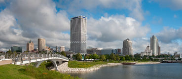 Milwaukee City Skyline. A photograph of the beautiful city of Milwaukee's skyline shortly after sunrise on a summer day as a weather front clears out Royalty Free Stock Photo