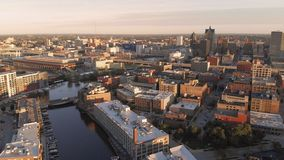Milwaukee river in downtown, harbor districts of Milwaukee, Wisconsin, United States. Real estate, condos in downtown. Aerial view. Drone flying stock images