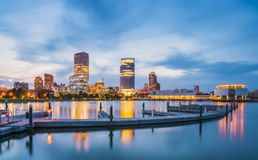Milwaukee skyline at night with reflection in lake michigan. royalty free stock image