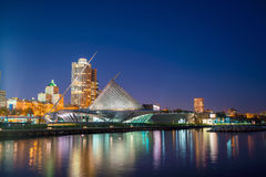 Milwaukee skyline. At twilight with city reflection in lake Michigan and harbor pier Stock Photos
