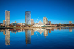 Milwaukee skyline in USA. Milwaukee skyline  with city reflection in lake Michigan and harbor pier Royalty Free Stock Image