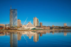 Milwaukee skyline in USA. Milwaukee skyline  with city reflection in lake Michigan and harbor pier Stock Image