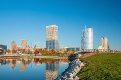 Milwaukee skyline in USA. Milwaukee skyline  with city reflection in lake Michigan and harbor pier Royalty Free Stock Images