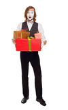 Mime actor holding gift boxes Stock Photography