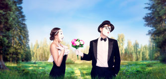 Mime actors performing with flower bouquet royalty free stock photography