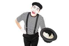 Mime artist collecting money in a hat Stock Photos