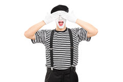 Mime artist covering his eyes Royalty Free Stock Photos