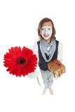 Mime Artist with flower - gerber and holding a gift Royalty Free Stock Photos