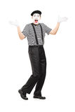 Mime artist gesturing joy with his hands. Full length portrait of a mime artist gesturing joy with his hands isolated on white background Stock Photo