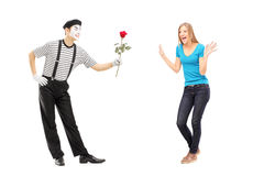 Mime artist giving a rose flower to an excited woman Royalty Free Stock Photos