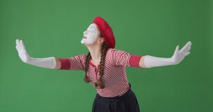 Mime artist greeting and showing heartfelt gratitude towards her fans from the stage