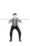 Mime artist holding a big metal pipe Royalty Free Stock Photo