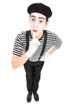 Mime artist holding a finger on his lips Stock Photography
