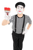 Mime artist holding a paintbrush Royalty Free Stock Photo