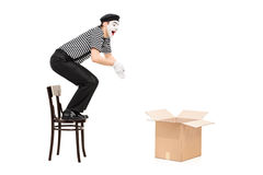 Mime artist jumping in an empty box Royalty Free Stock Images
